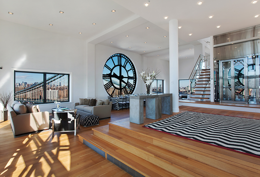Clock-Tower-Apartment-levels-of-open-plan-living-wood-flooring-down-lit