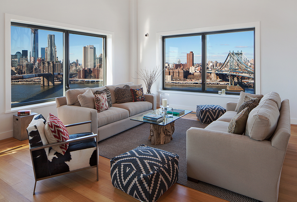Clock-Tower-Apartment-neutral-sitting-area-with-views-to-New-York-City-and-statement-soft-furnishings