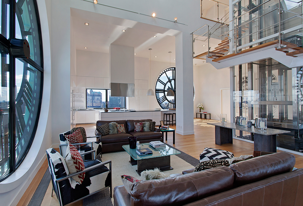 Clock-Tower-Apartment-open-plan-living-in-white-with-glass-panelled-staircase-and-elevator