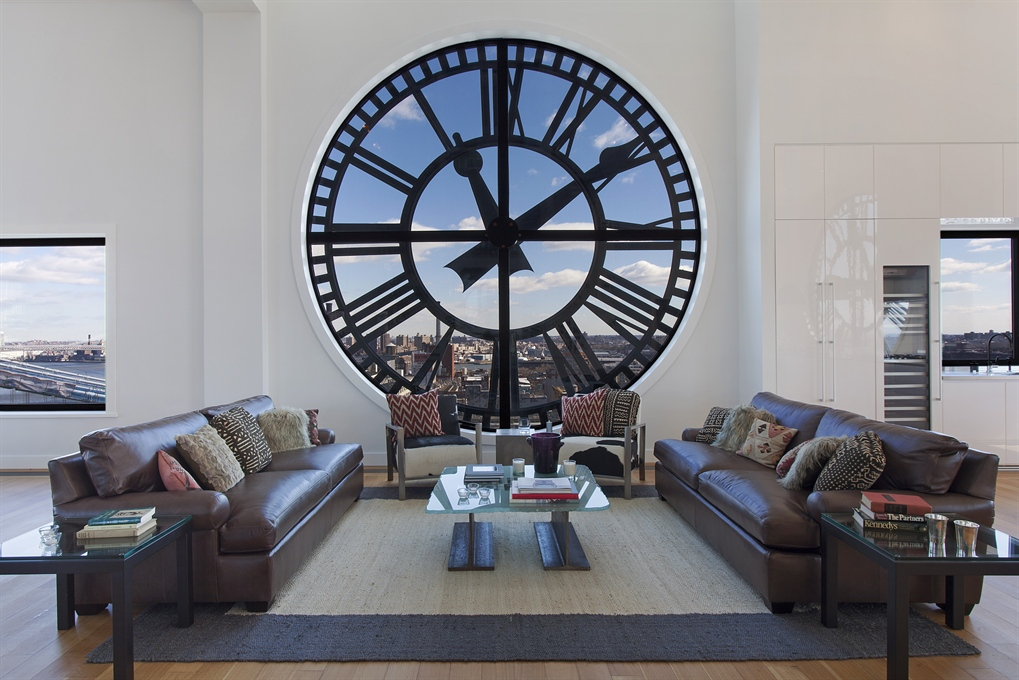 Clock-Tower-Apartment-White-open-plan-living-with-clock-face-window-leather-and-textural-rug