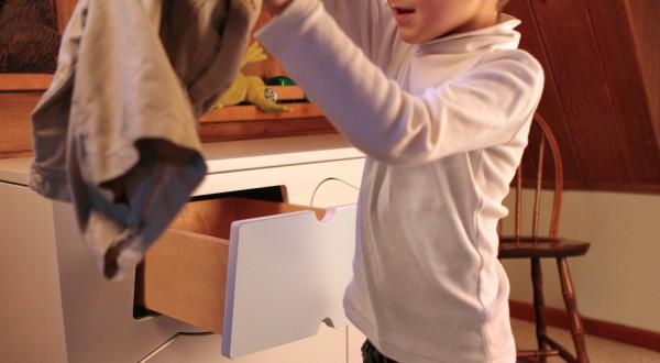 A-Training-Dresser-holding-shorts-2-600x330