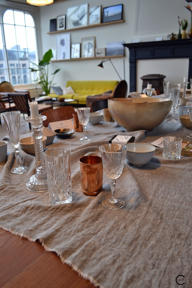 THE LOFT AMSTERDAM PLAYING CIRCLE DECEMBER 2014 BY C-MORE INTERIOR BLOG YELLOW SOFA OLD WOODEN FLOOR ARTWORK ON WALL LINNEN TABLE CLOTH CHRISTAL GLASS COPPER BOWLS