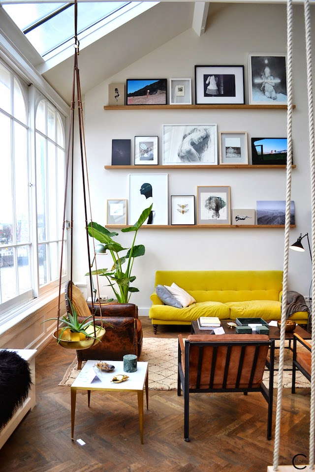 THE LOFT AMSTERDAM PLAYING CIRCLE DECEMBER 2014 BY C-MORE INTERIOR BLOG YELLOW SOFA PICTURES ART ON WALL STYLING PLANTS CHAIR OLD WOOD FLOOR LAMP