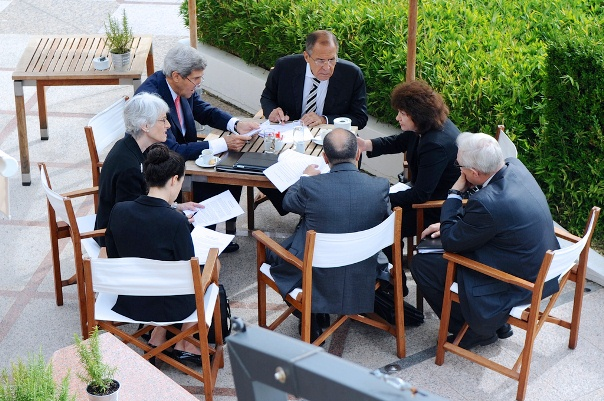 September 14, 2013 - U.S. Secretary of State John Kerry, his Russian counterpart, Foreign Minister Sergey Lavrov, and their senior advisers meet on the pool deck of the Hotel Intercontinental in Geneva, Switzerland, during their final negotiating session over an agreement to eliminate Syrian chemical weapons. [State Department photo/ Public Domain]