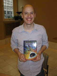 Author Lev Grossman Holds Up a Book Not His Own