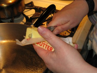 Nomi Prepares to Melt Butter in Frying Pan