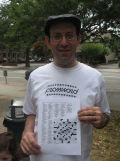 Andrew Greene Holding Up His First New York Times Crossword Puzzle