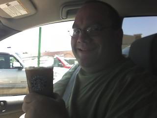Joshua Enjoys a Refreshing Starbucks Coffee