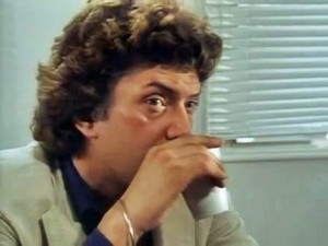 Doyle sipps his tea seconds befor Bodie uses the beaker