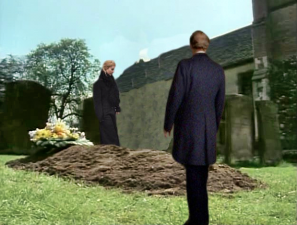 Cowley standing at Davids grave