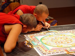 Monks concentrate over the mandala