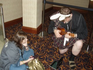 Neil Innes plays ukulele, too.