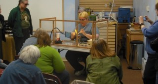 Picture of me doing a flameworking demo for the Madison Bead Society