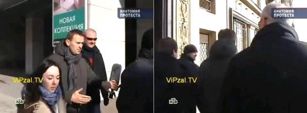 Алексей Навальный покидает митинг в сопровождении телохранителей