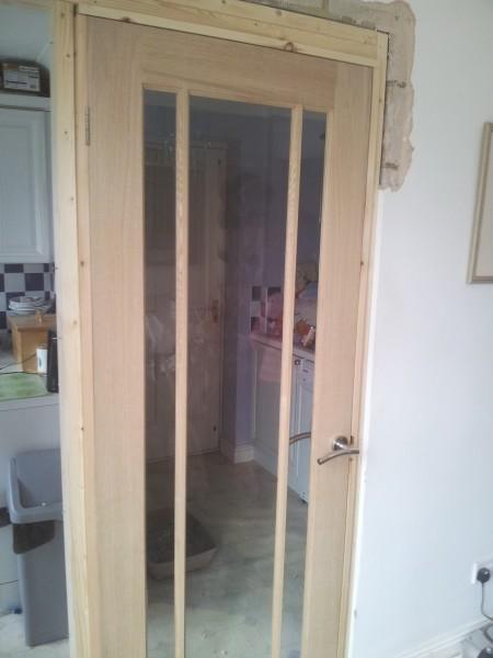 Kitchen archway with door