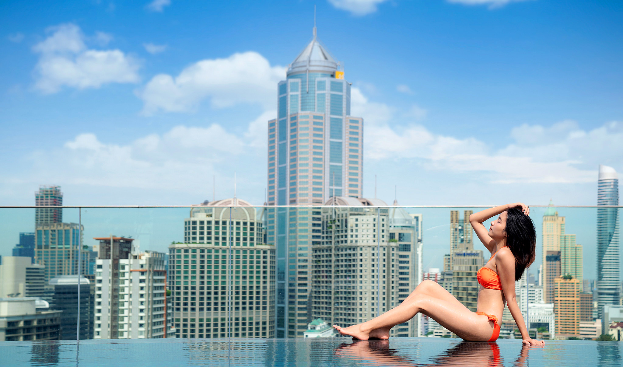 Relax in rooftop swimming pool with Bangkok city background by Anek Suwannaphoom.jpg