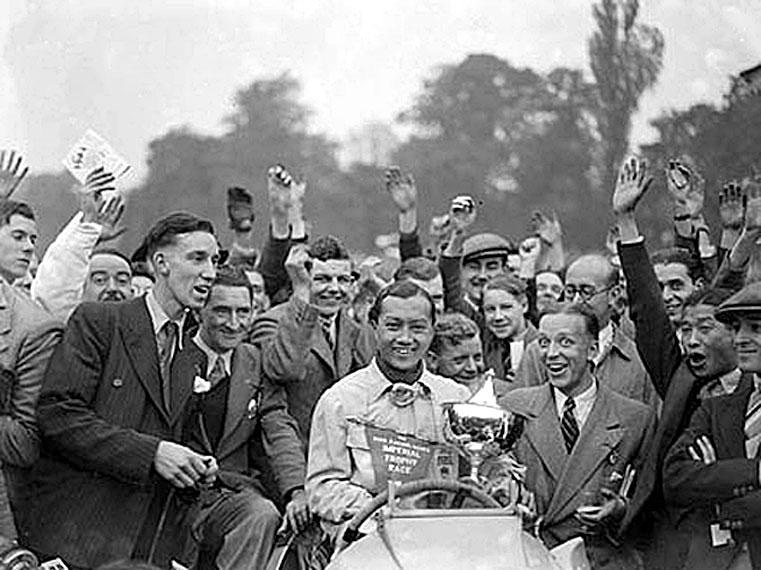 1937 October Prince Bira of Siam celebrating after winning.jpg