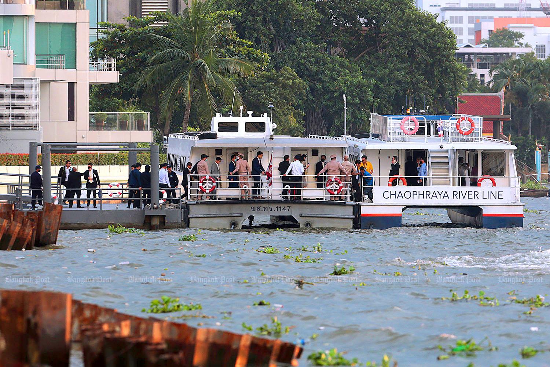 Senators leaving Parliament by Chanat Katanyu.jpg