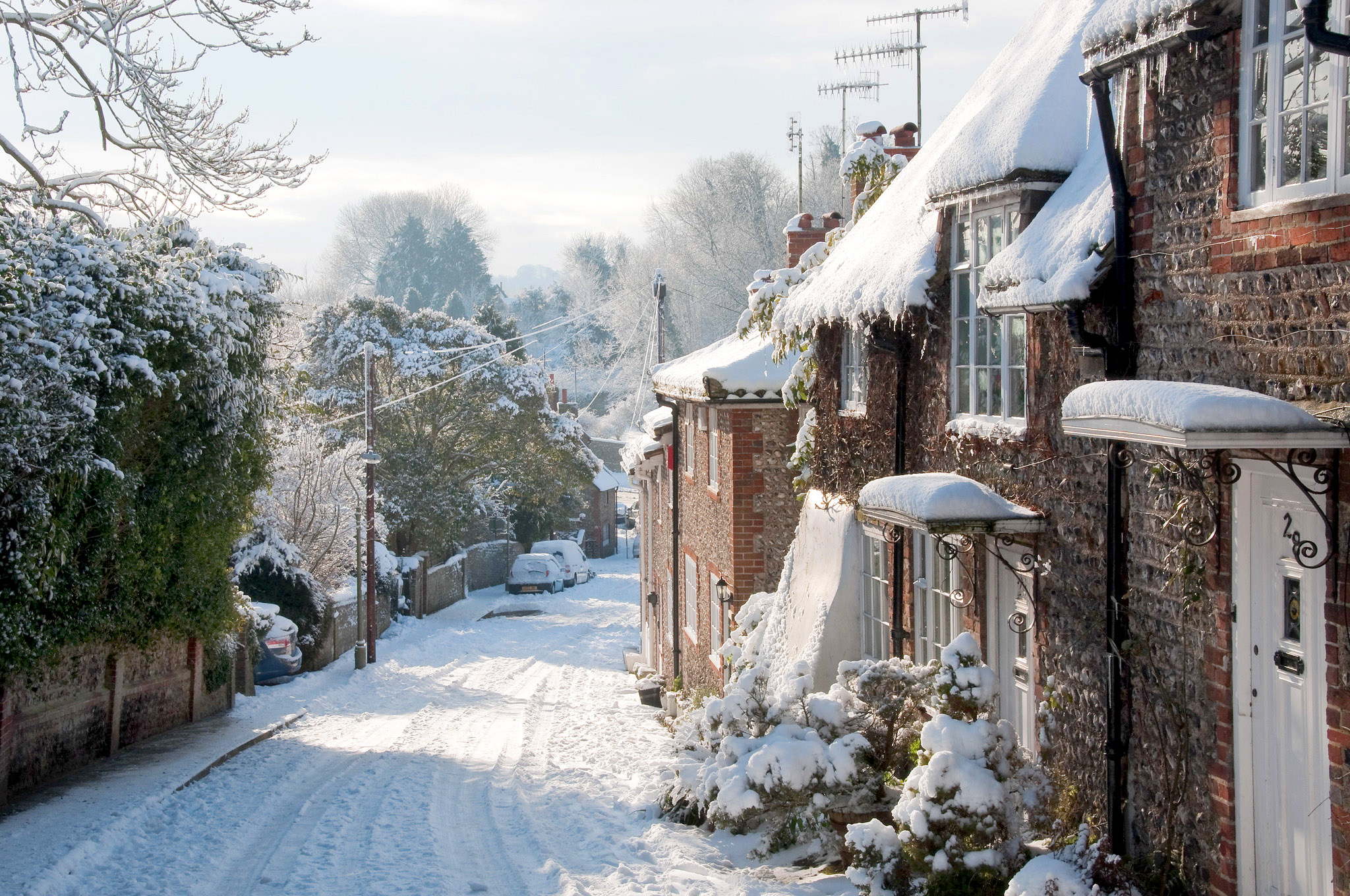 A snowy street in Patcham, East Sussex by Alan Bloom.jpg