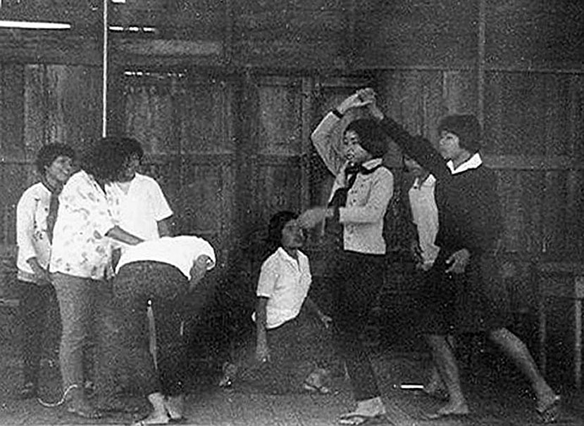 1969 Rather confused Loei school girls attempting square dancing.jpg