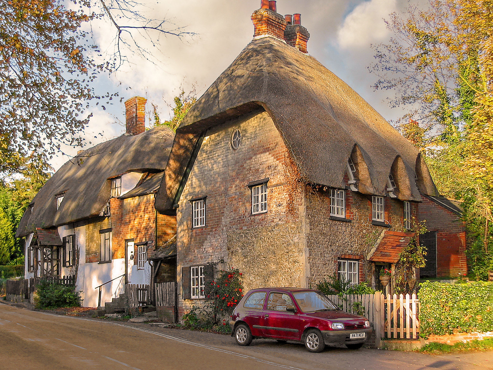 Cottages in the Thames-side village of Clifton Hampden, Oxfordshire by Andrew S Brown.jpg