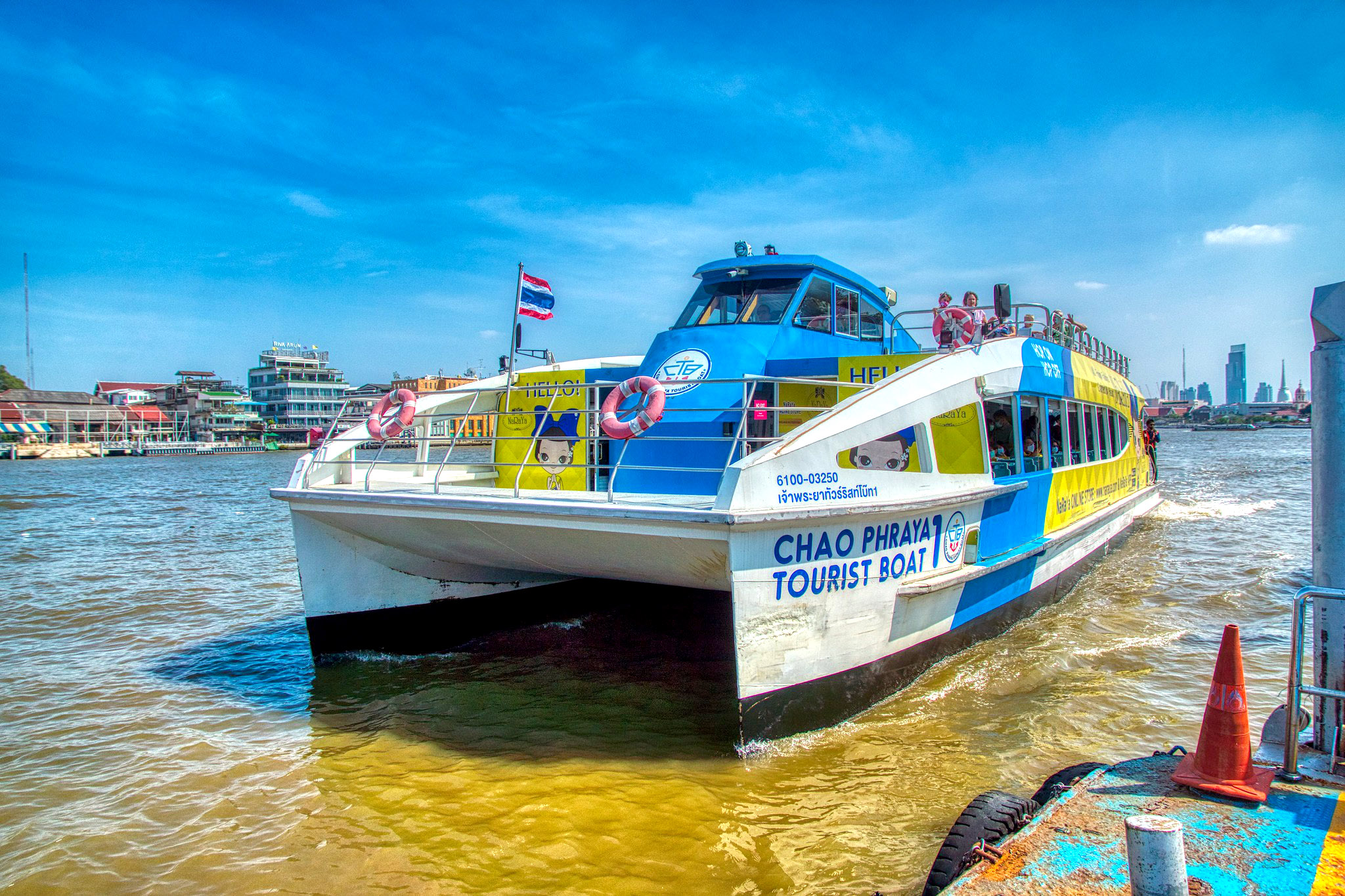 Catamaran tourist boat on the Chao Phraya rive by Uwe Schwarzbach.jpg