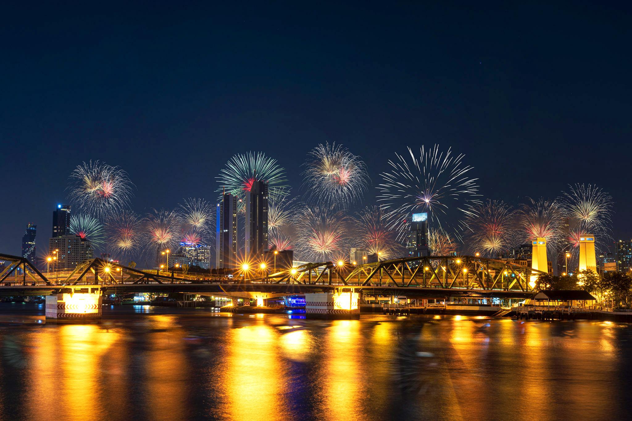 Firework New year Celebration at the Phra Phuttha Yodfa Bridge, Memorial Bridge 2021 by Thirawatana Phaisalratana.jpg