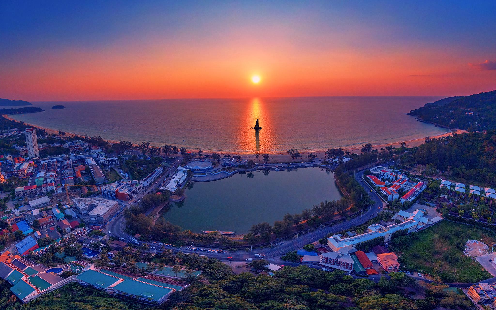 Sunset sailing, Karon beach, Phuket by Mike Leung.jpg