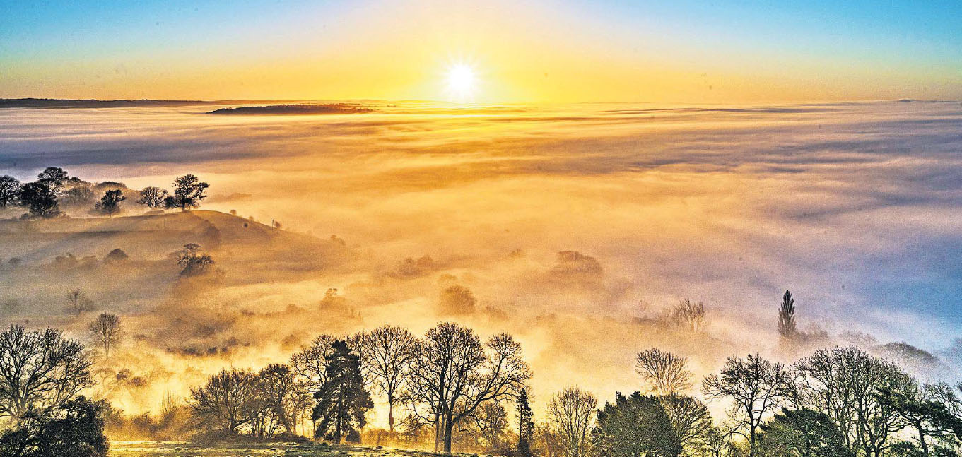 Early morning mist swathes Glastonbury, Somerset by Michelle Cowbourne.jpg