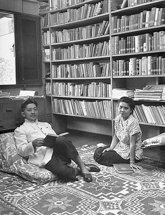 1950 Prince Chumphot and wife in their library.jpg