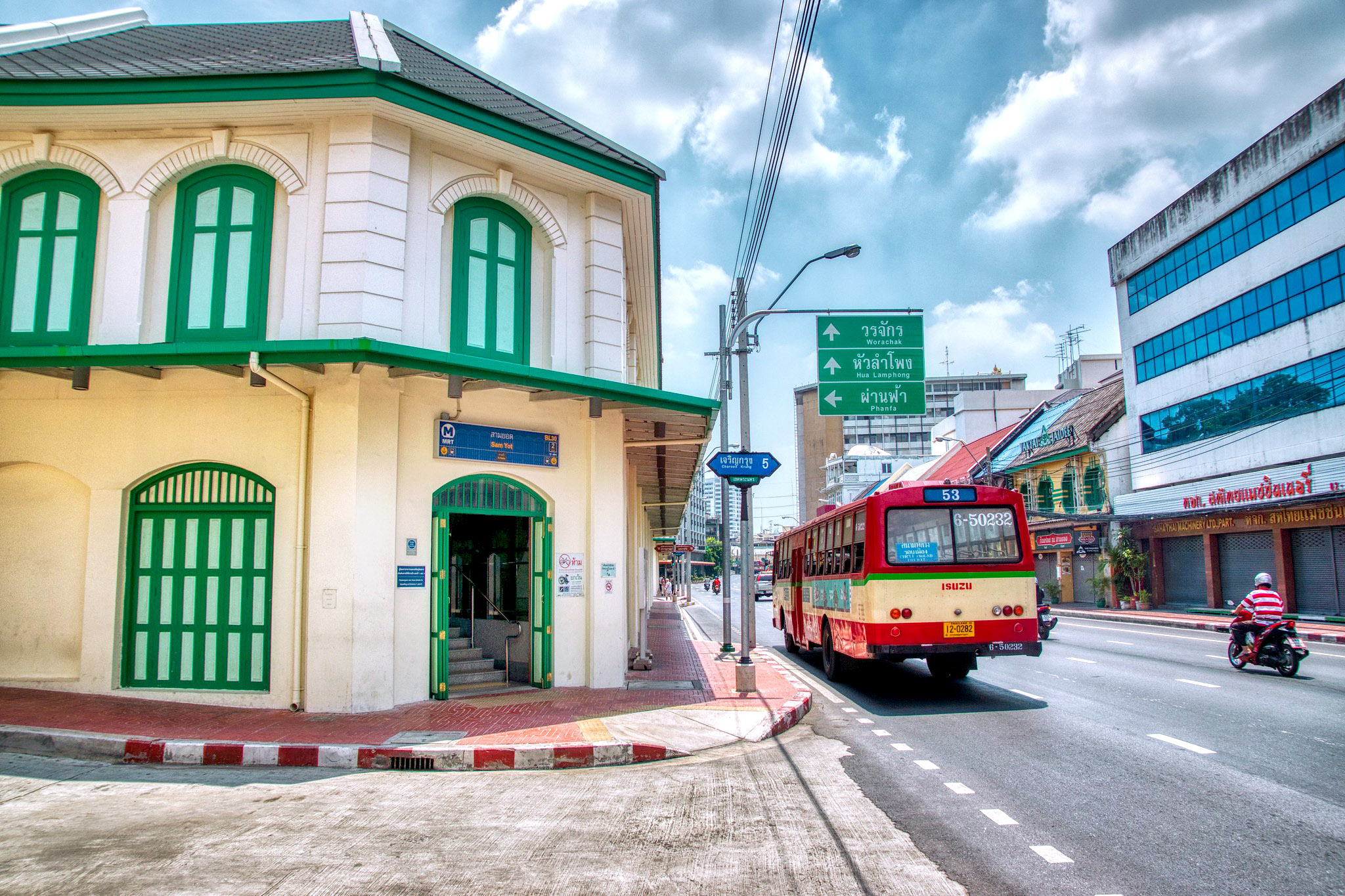 Bus passing the exit of Sam Yot MRT station on Charoen Krung road on Rattanakosin island by Uwe Schwarzbach.jpg