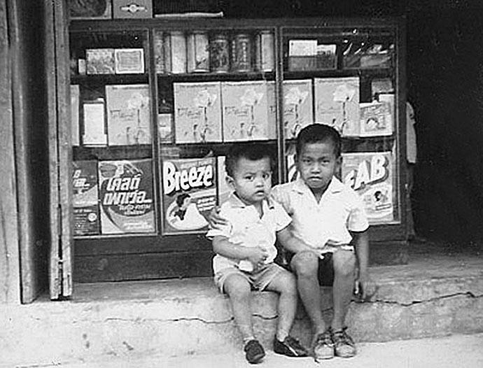 1963 Brothers pose on step of Bangkok storefront.jpg
