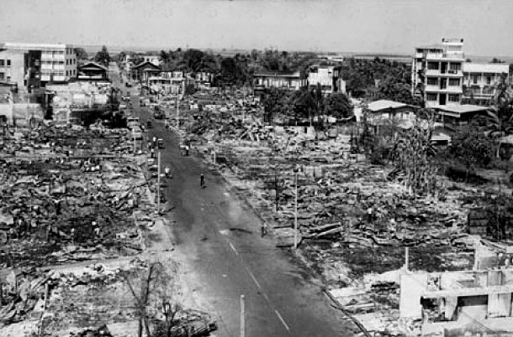 1973 Aftermath, Fire of Sakon Nakon's commercial centre.jpg