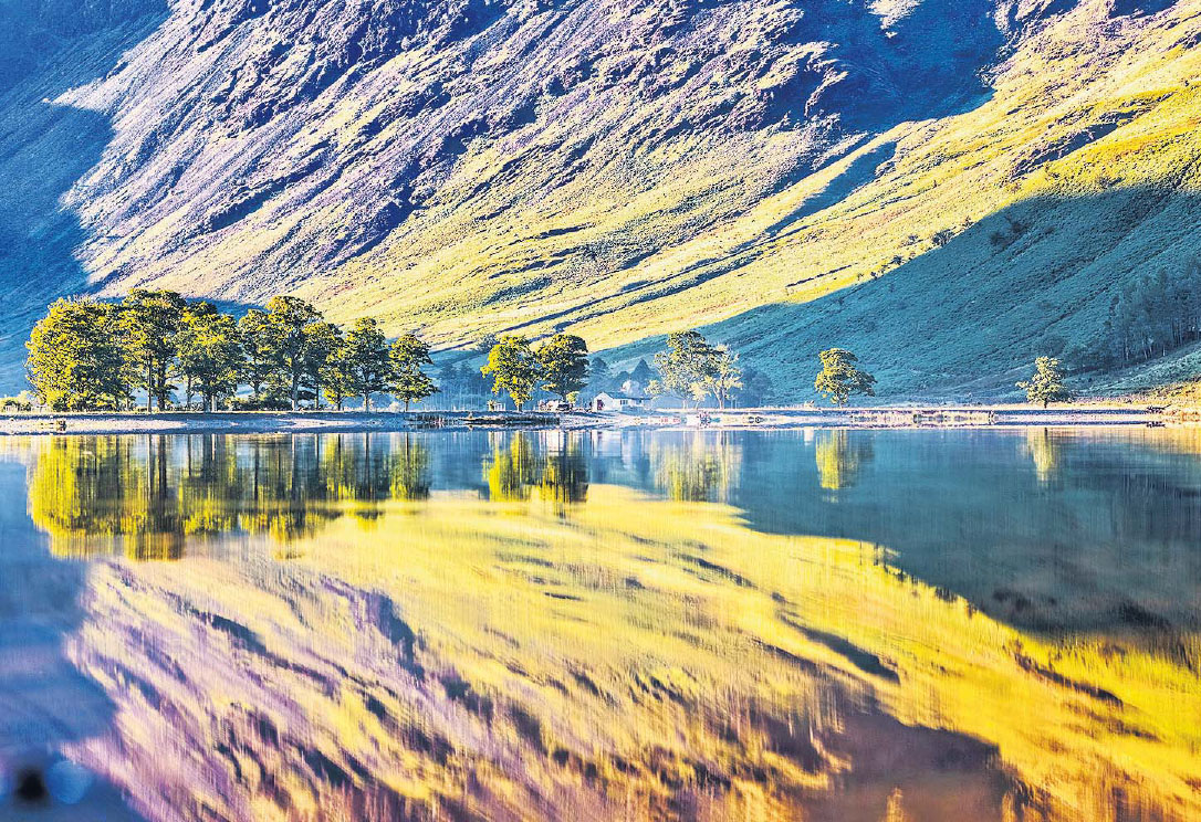 Haystacks and the Little White Hut are reflected in Buttermere in the Lake District by Andrew McCaren.jpg