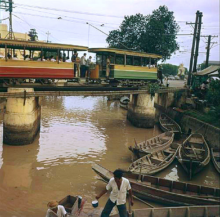 1961 Tram crossing a canal now covered by the approach road to Phra Pinklao Bridge by Jack GAROFALO.jpg