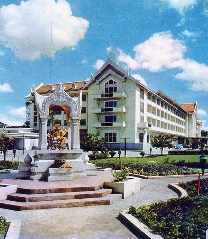 1968 Erawan Shrine with the old Erawan Hotel.jpg