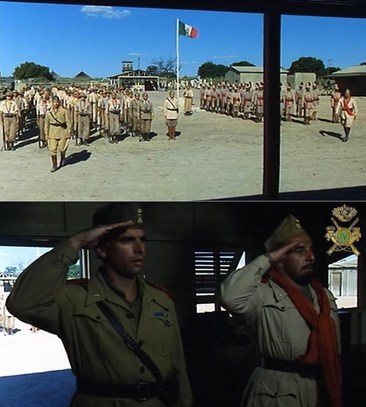 Построение. Командиры пехоты и туземцев идут на доклад. Итальянский офицер носит кушак, как у своих подчиненных, и кокарду RCTC (зеленый центр - Эритрея и Сомали), кант погон - в цвет кушака части. И разумеется сахариана...