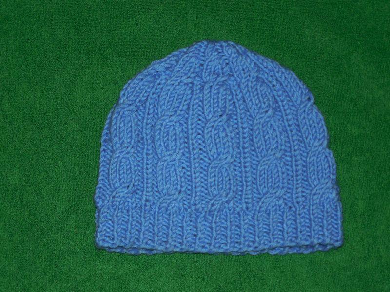 шапка голубая косы