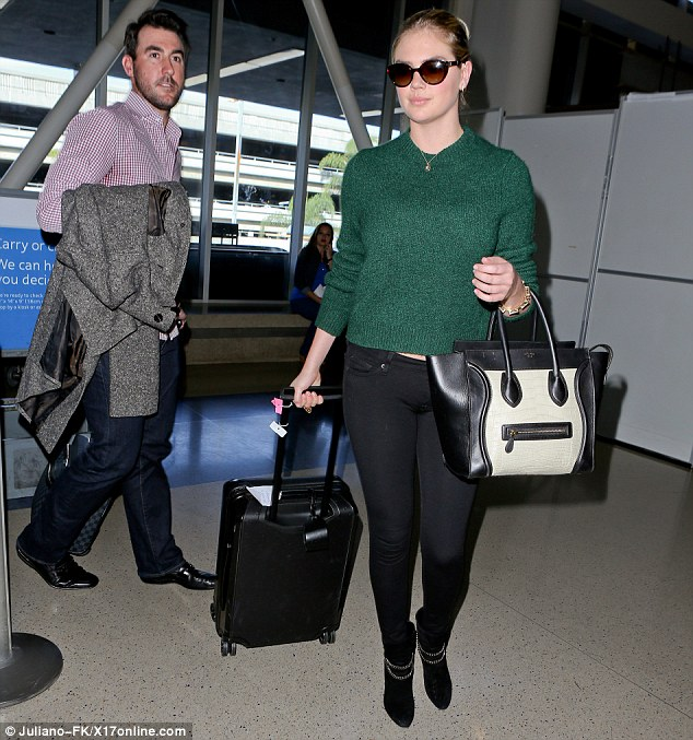 1416183275286_Image_galleryImage_Kate_Upton_arrives_at_LAX