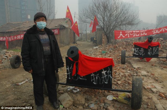 httpwww.dailymail.co.uknewsarticle-2528994Elderly-Chinese-man-deployed-six-homemade-CANNONS-stop-home-demolished-without-consent.html