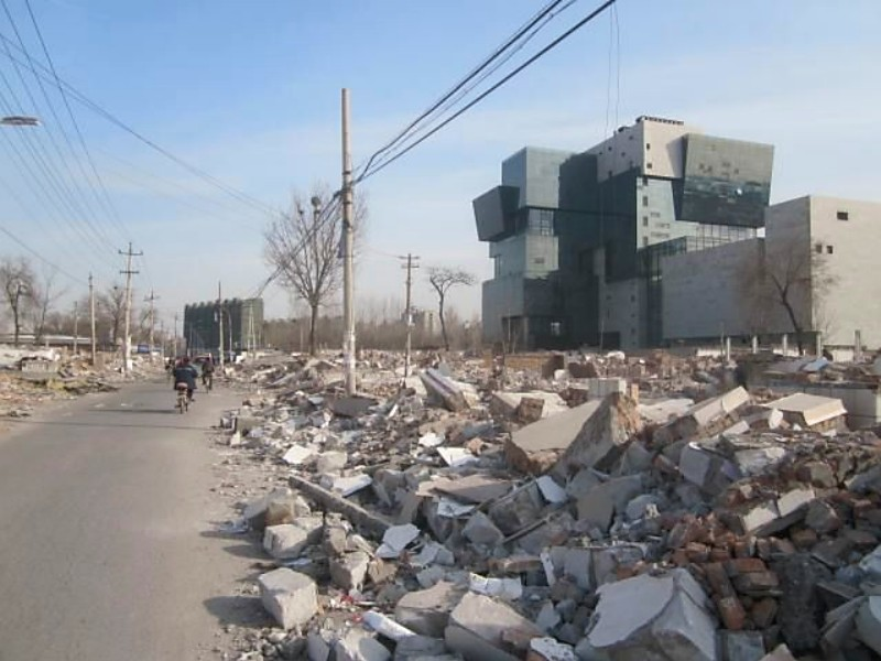 Houshayu rubble with office building rising out