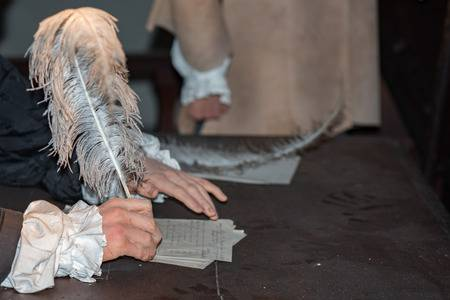 55190834-hands-while-writing-a-letter-with-a-plume