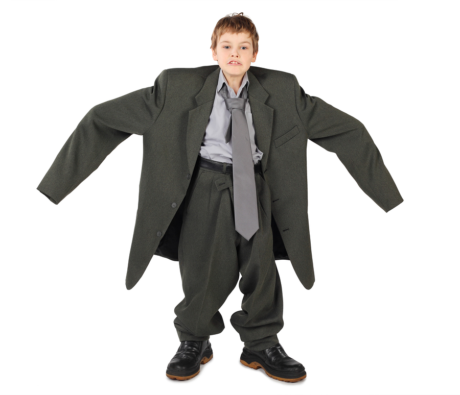 bigstock-Little-Boy-In-Big-Grey-Man-s-S-8054825-wrong-size-oversized-one-size-fits-all