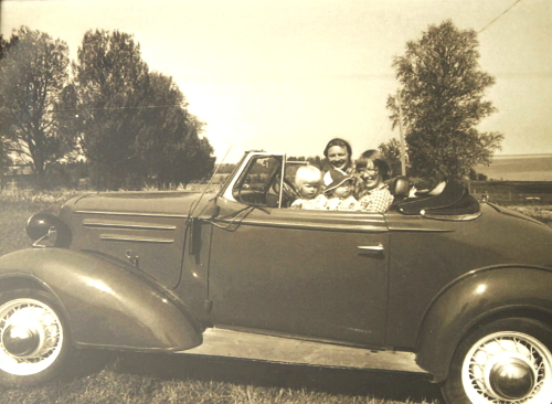The whole family. Me, Mom, Dad, my Sister and the Chevy.