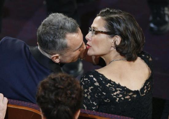 Actor Daniel Day Lewis is kissed by his wife Rebecca Miller after winning the Oscar, Lincoln