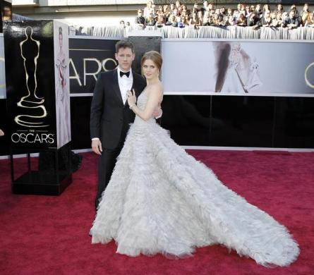 Amy Adams, best supporting actress, in The Master, and her husband, Darren Le Gallo