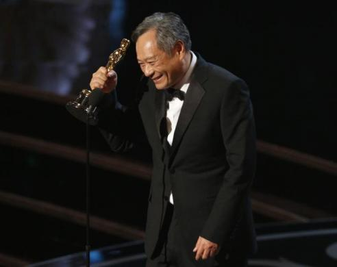 Director Ang Lee reacts after winning the Oscar for best director for Life of Pi