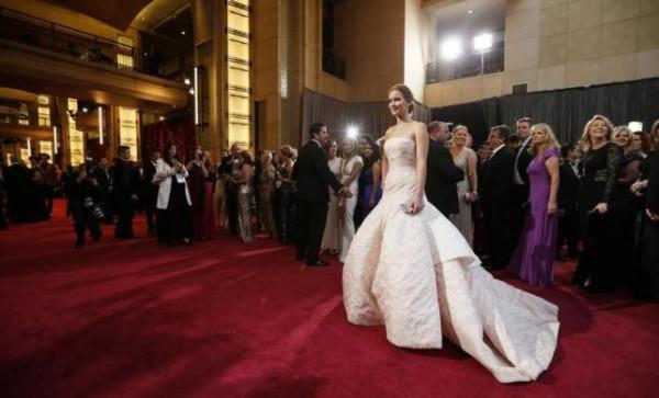 Jennifer Lawrence wears a white Dior