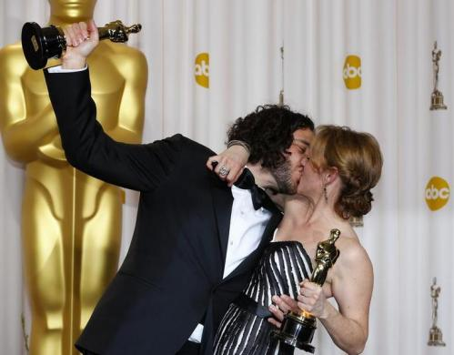 Sean Fine and Andrea Nix Fine pose with their Oscars after winning the Best Documentary Short Subject for their film Inocente