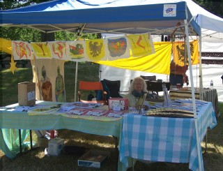 Here I am in our Strawberry Festival booth July 17th. It's just a canopy, no walls. Suzanna took the picture